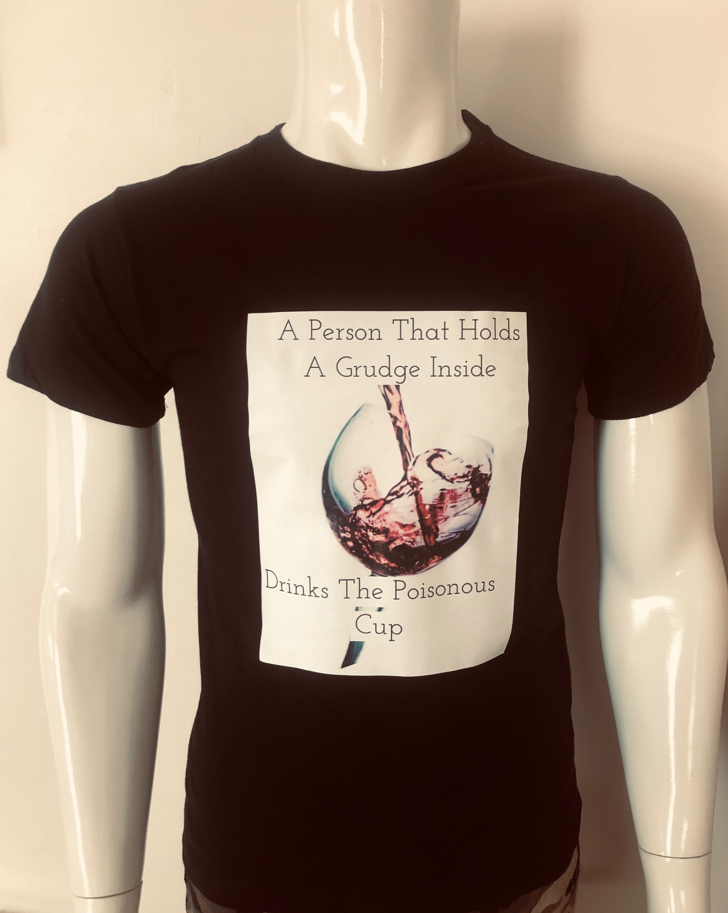 A Person That Holds A Grudge Inside Drinks the Poisonous Cup T-Shirt - Black